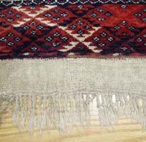 Fringe replacement: new fringe is created by stitching threads into linen fabric. The fabric is then attached onto rug.